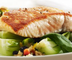 Healthy grilled salmon with brown rice salad